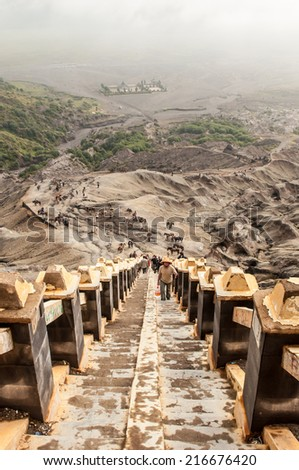 Java,Indonesia-Arpil 25,2010 : Tourists hiking to Mount Bromo volcano,The active Mount Bromo is one of the most visited tourist attractions in East Java , Indonesia. - stock photo