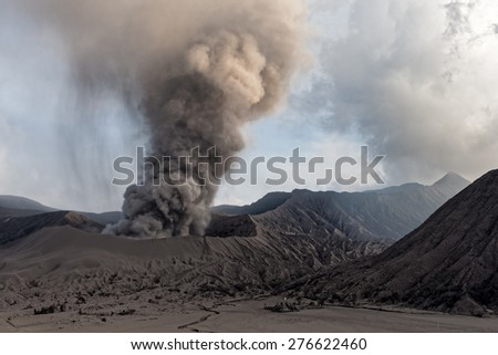 JAVA, INDONESIA - JULY 1: Mount Bromo erupts spewing out ash and smoke on July 1, 2011 in Java, Indonesia. Indonesia sits on the 'ring of fire' with many active volcanoes and prone to earthquakes. - stock photo
