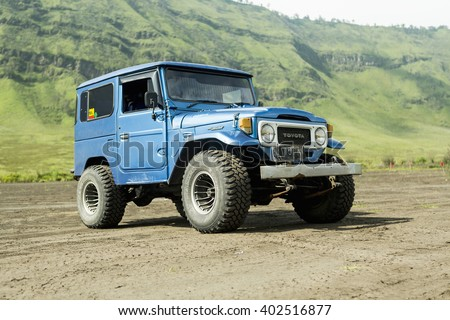 Java, Indonesia- March, 24, 2016 : Blue 4x4 Jeep for tourist at caldera of volcano Mount Bromo, East Java , Indonesia.