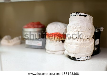jaws in cabinet of dental clinic. - stock photo