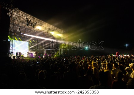 JAZ, MONTENEGRO - JULY 16: Audience infront of the Main Stage at SEA DANCE Festival, during DJAJKOVSKI & TK WONDER performanse, on July 16, 2014  at the Jaz beach near Budva,  Montenegro. - stock photo