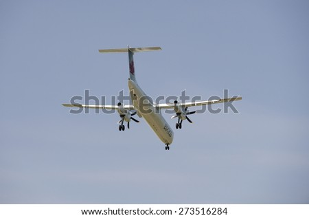 JAZZ AIR - MAY 31, 2014: Air Canada EXPRESS is also named as Air Canada JAZZ or Jazz Air. 2 Turboprop engine aircraft DASH 8-MSN 4381 lands in Vancouver International Airport. British Columbia Canada - stock photo