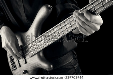 jazz bassist playing,vintage style photo - stock photo