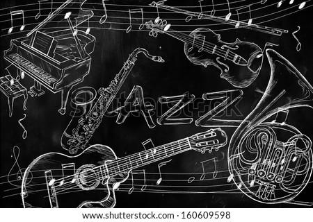 Jazz instruments music background on dark blackboard - stock photo