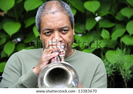 Jazz musician performing on a flugelhorn. - stock photo