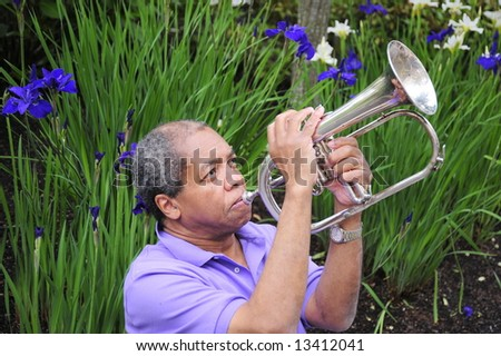 Jazz musician playing to the heavens above. - stock photo