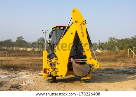 JCB machinery  parking in field, Utility machine used for soil work.  - stock photo
