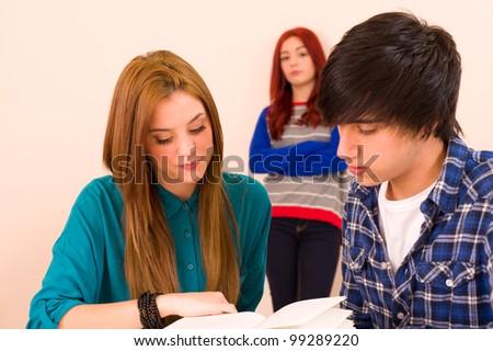 Jealous girl watching her classmates - stock photo