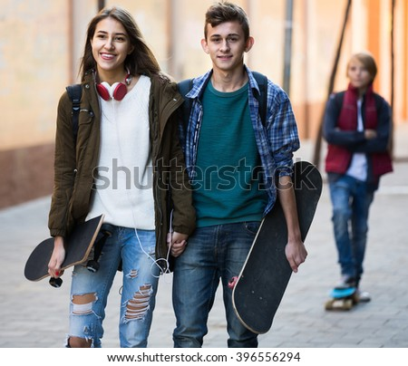 Jealous upset teen and his friends after conflict outdoors  - stock photo