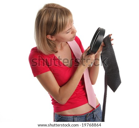 Jealous wife in search proofs attentively considers a tie of the husband - stock photo