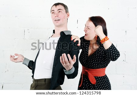 Jealous woman screaming at her kissed man - stock photo