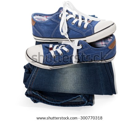 Jeans and blue sneakers isolated on white background - stock photo