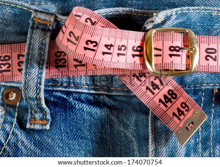 Jeans and centimeter. Belt with buckle - stock photo