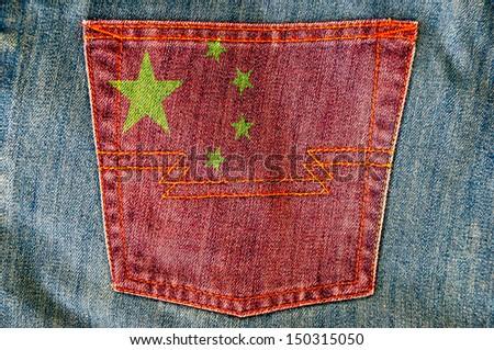 Jeans back pocket on China flag  - stock photo