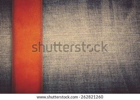 Jeans background with brown belt - stock photo