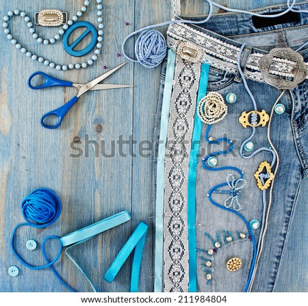Jeans decorated with ribbons and lace by hand - stock photo