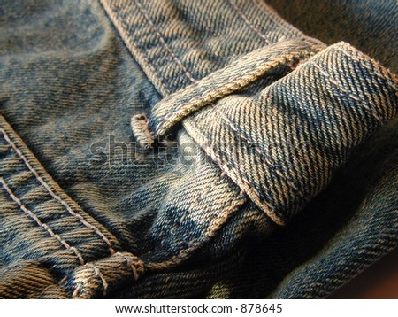 jeans detail - back pocket and buckle loop - stock photo