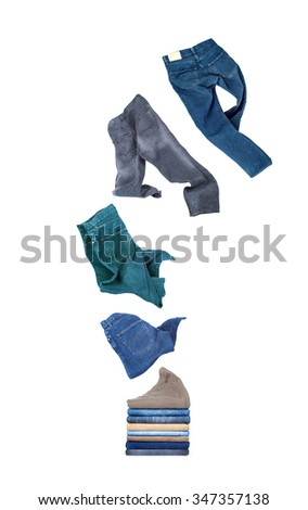 jeans flies on a pile isolated on white background - stock photo