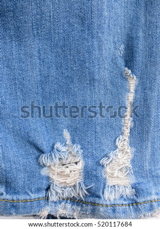 Jeans leg torn denim texture for background