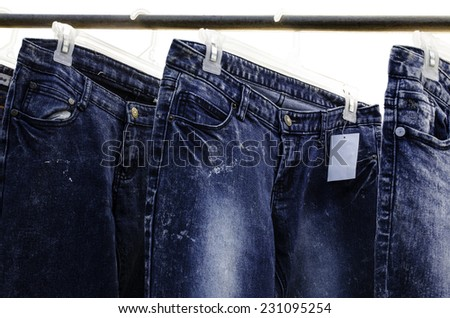 Jeans on hangers for sale. - stock photo