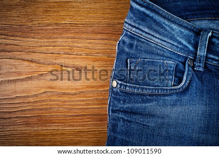 jeans on wood background with place for text - stock photo
