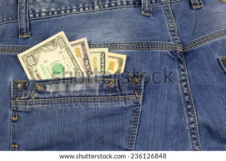 Jeans Pocket  Full of American Dollar Bills - stock photo