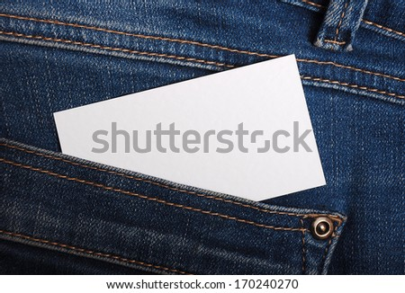 Jeans pocket with calling card - stock photo