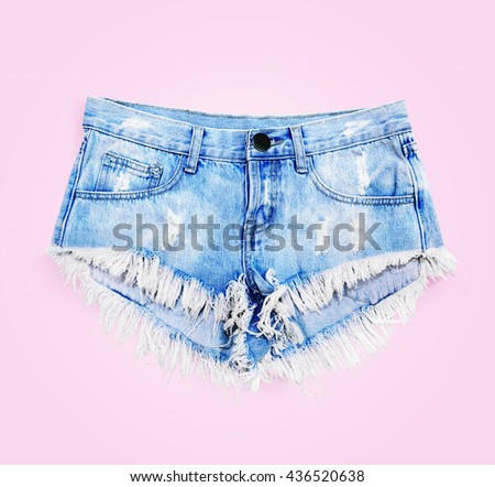 jeans shorts on a pink background