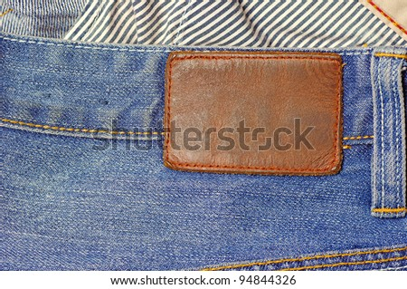 Jeans texture with leather label