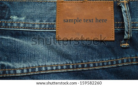 Jeans texture with seams (with sample text) - stock photo