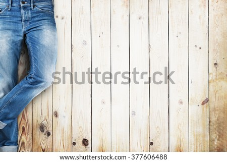 Jeans trouser over white wood planks background - stock photo