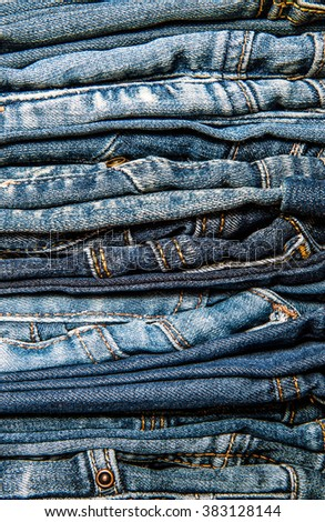 Jeans trousers stack close up - stock photo