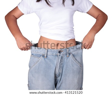 Jeans with a big old Slim girl from a good diet ago Close-up slim waist of young woman in big jeans showing successful weight loss, isolated on white background, diet concept.  - stock photo