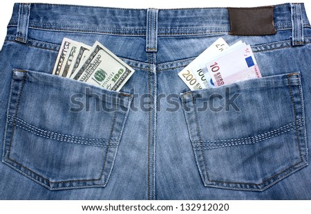 jeans with a different currency in their pockets - a symbol of balance between the euro and the dollar - stock photo