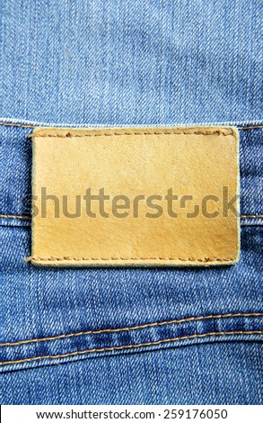 Jeans with blank leather label - stock photo