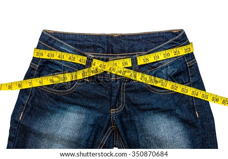 Jeans with measuring tape isolated on white - stock photo