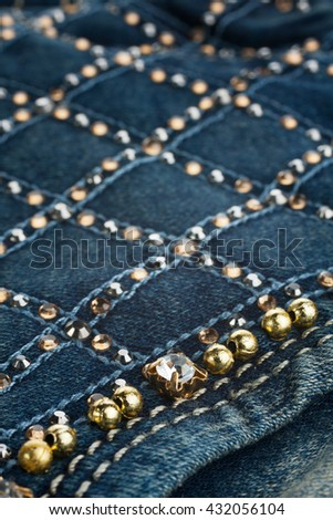 Jeans with pockets close-up decorated with rhinestones, may be used as background