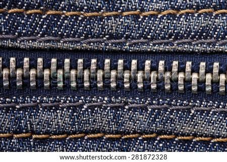 Jeans zipper close up blue seams - stock photo