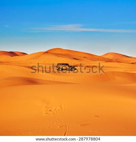 Jeep in sand dunes in the Sahara Desert, Merzouga, Morocco