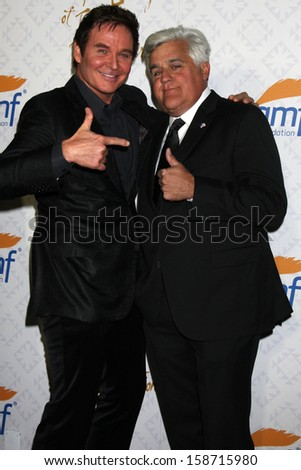 Jeff Trachta and Jay Leno at the 10th Alfred Mann Foundation Gala, Robinson-May Lot, Beverly Hills, CA 10-13-13 - stock photo
