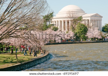 Jefferson Memorial and the Tidal Basin during the National Cherry Blossom Festival - stock photo