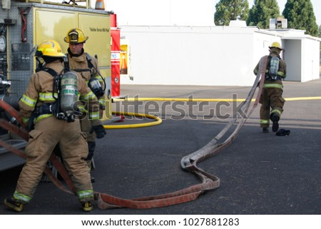 Jefferson,Oregon/USA - 08-16-2008  Fire fighters stretching out the hose