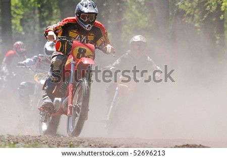 JEFFERSON, TEXAS - APRIL 5:  Dirt and dust surround start of motocross race as riders relive past glories in AHRMA Vintage Motocross National Championship race in Jefferson, TX on April 5, 2009. - stock photo
