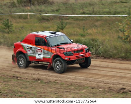JEKABPLIS, LATVIA-SEPTEMBER 22: Tapio Souminen and Markku Hurskainen drives Mitsubishi Pajero during a motoring event RIGA BAJA 2012 in Jekabpils, Latvia on September 22, 2012.
