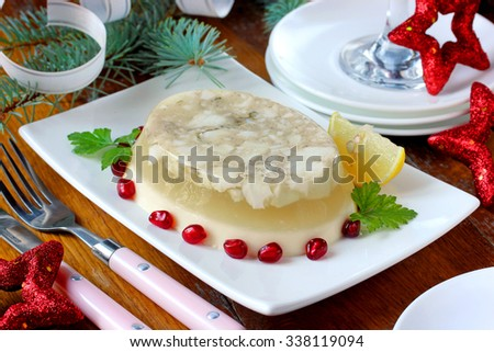 Jellied fish on a festive New Year's table, selective focus - stock photo