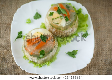 Jellied fish with egg and vegetables on a plate - stock photo