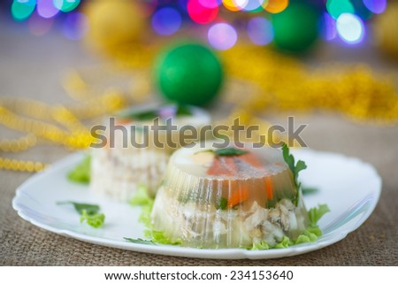 Jellied fish with egg and vegetables on an abstract background - stock photo