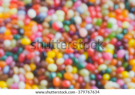Jelly beans colorful blurred background, from above view - stock photo