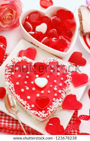 jelly cake in heart shape with white pearls topping for valentine`s party