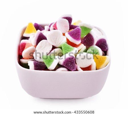 Jelly candy fruit in bowl on white background